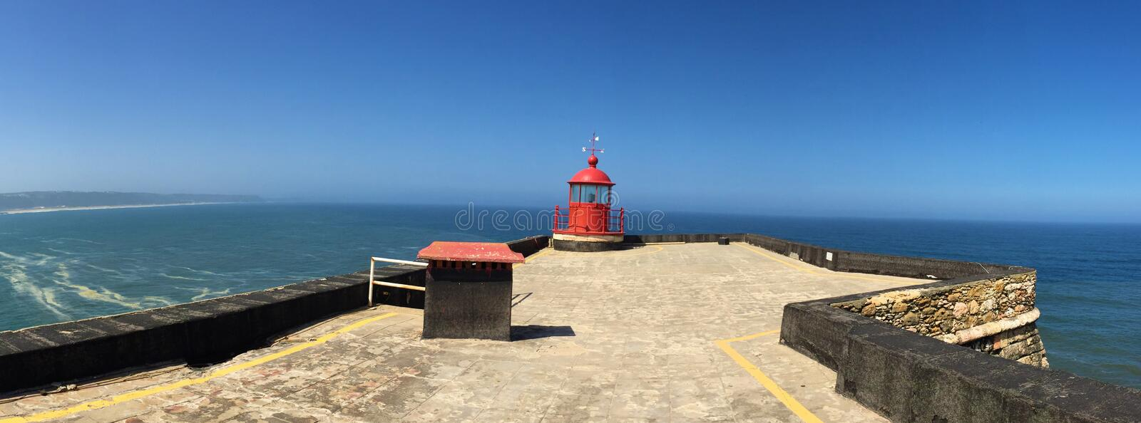 Nazare - lighthouse by the biggest waves in the world stock photos