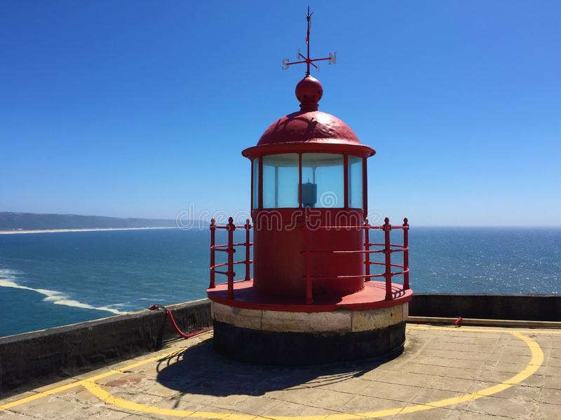 Nazare - lighthouse by the biggest waves in the world royalty free stock photo