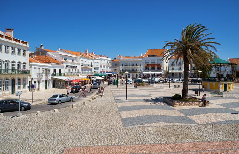 The central square of Nazare. Portugal. NAZARE, PORTUGAL - JUNE 26, 2016: The view of the central square of Nazare surrounded by the line of residential houses royalty free stock photography