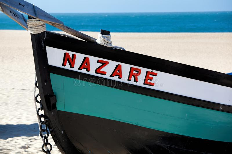 Nazare, Portugal - November 5, 2017: colorful traditional old wooden fishing boat on the beach of fishing village of Nazare . royalty free stock photography
