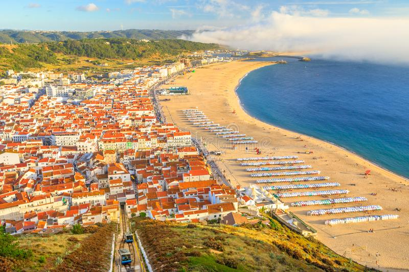 Nazare Portugal Skyline. Aerial view of skyline and beach waterfront from Miradouro do Suberco in Nazare Sitio, the upper part of the city above the giant cliffs royalty free stock image