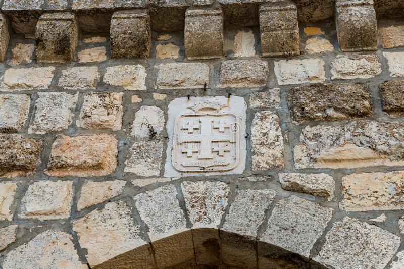 Coat of arms over the main gate to the Christian Temple of the Transfiguration located on Mount Tavor near Nazareth in Israel. Nazareth, Israel, August 31, 2019 royalty free stock image