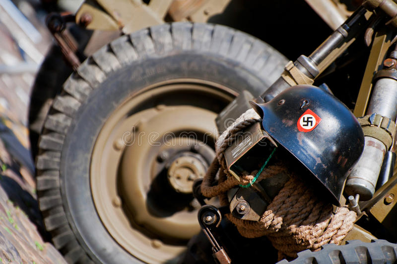 Nazi Helmet on American Jeep stock photography
