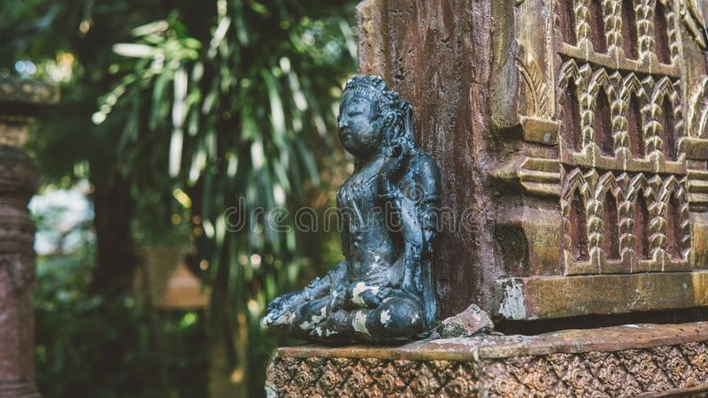 NBalinese traditional stone statues in the form of demons and gods close-up. Balinese traditional stone statues in the form of demons and gods close-up royalty free stock image
