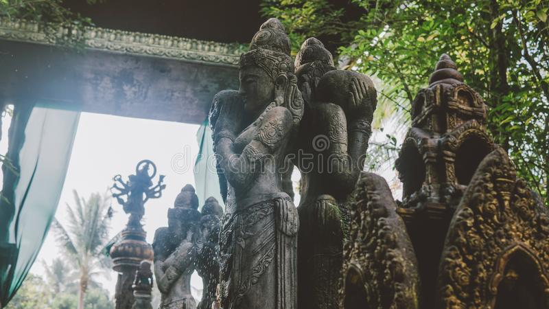 NBalinese traditional stone statues in the form of demons and gods close-up. Balinese traditional stone statues in the form of demons and gods close-up stock photography