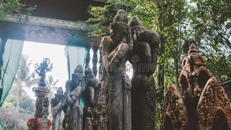 NBalinese traditional stone statues in the form of demons and gods close-up. Balinese traditional stone statues in the form of demons and gods close-up stock photo