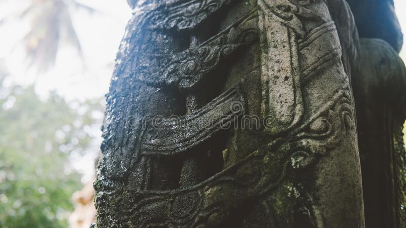 NBalinese traditional stone statues in the form of demons and gods close-up. Balinese traditional stone statues in the form of demons and gods close-up stock image