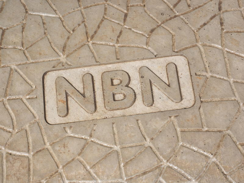 NBN wording on a new roadside pit. Melbourne, Australia - October 22, 2016: NBN wording on a new roadside pit of the Australian National Broadband Network hybrid royalty free stock photo