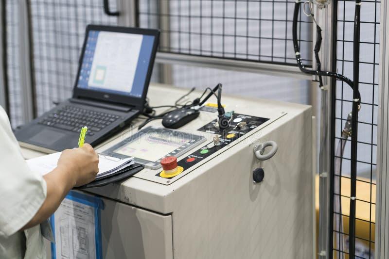 NC Machine control panel closup, automatic robot input program a stock photos