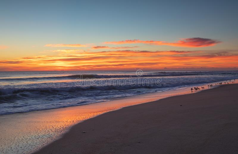 NC Sunrise Sky Over Ocean Outer Banks. Sunrise sky over the Atlantic Ocean on seashore in the Outer Banks, Buxton, North Carolina stock photos