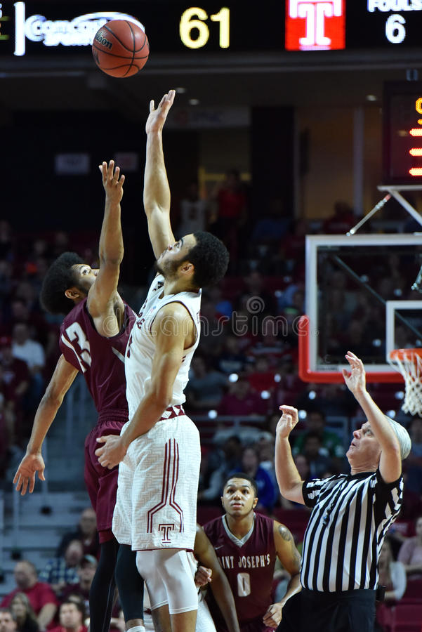 2015 NCAA Basketball - St Joe's at Temple. PHILADELPHIA - DECEMBER 13: Temple Owls forward Obi Enechionyia (0) jumps the opening tip-off go overtime during the stock photography