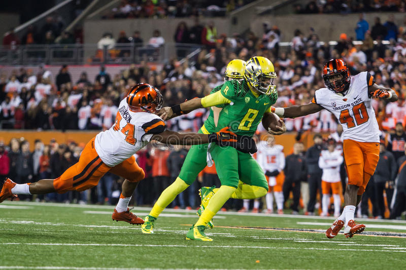 NCAA Football - Oregon at Oregon State. Oregon Ducks quarterback Marcus Mariota (8) with a run during the Civil War rivalry game at Reser Stadium royalty free stock images