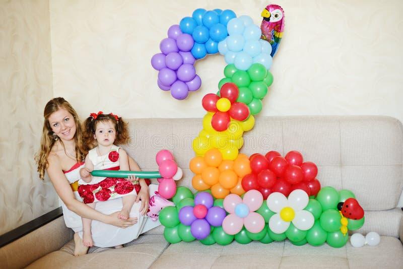 2-nd birthday. Og toddler girl at home stock images