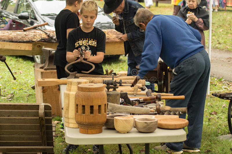 32nd Heritage Day – Camp Bethel, VA, USA. 32nd Brethren Heritage Celebration, Fincastle, VA – October 1st: Visitors looking at a woodworking booth royalty free stock images