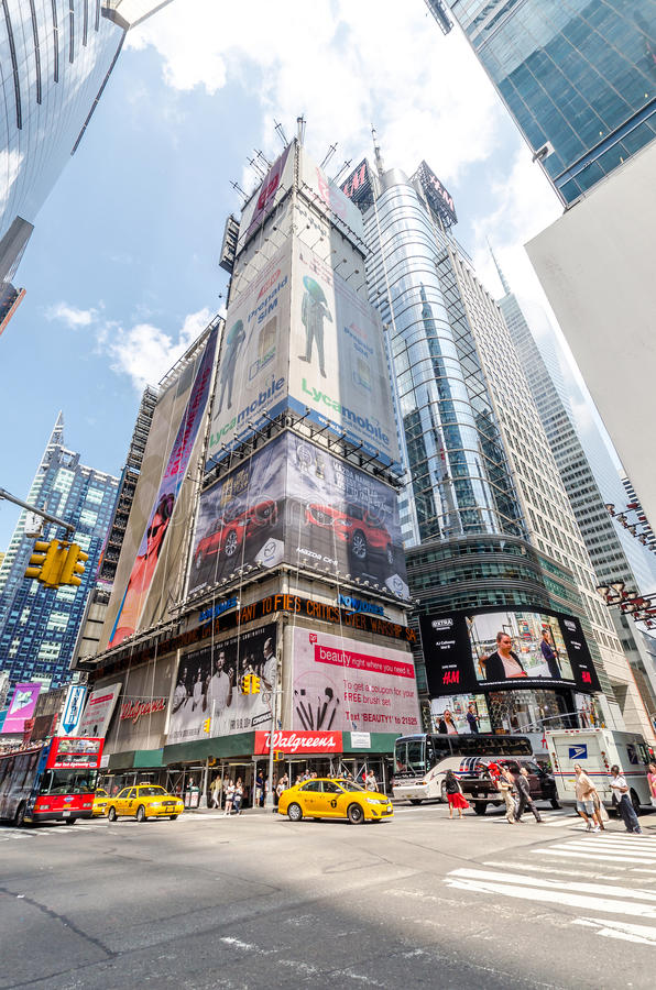 42nd Stree. NEW YORK - JUL 22: 42nd Street near Times Square with traffic and commercials on July 22, 2014 in New York. 42nd Street is a major crosstown street royalty free stock image