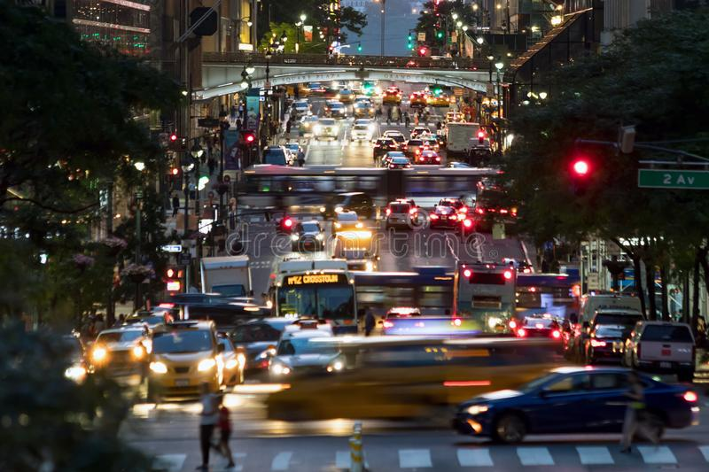 42nd Street is crowded with lights of crosstown traffic in New York City. 42nd Street is crowded with the busy night lights of crosstown traffic through Midtown royalty free stock photo
