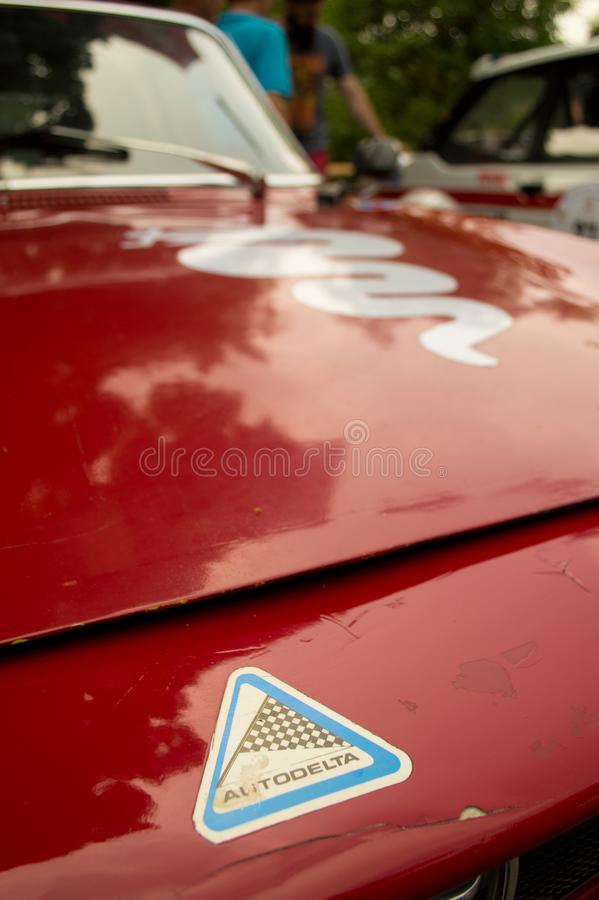 Utodelta at Vernasca Silver Flag 2017. 22nd Vernasca Silver Flag 2017 Detail of an Alfa Romeo GTV of the team Autodelta. In evidence the symbol of the team and royalty free stock photos