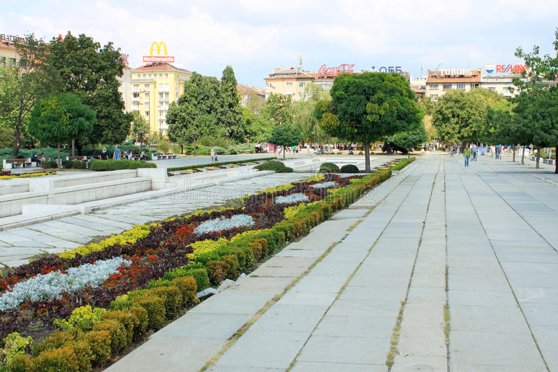 NDK Park in Sofia, Bulgaria. SOFIA, BULGARIA - CIRCA AUGUST 2013 - People walking in NDK park in the center of Sofia, the capital of Bulgaria on a cloudy day royalty free stock image