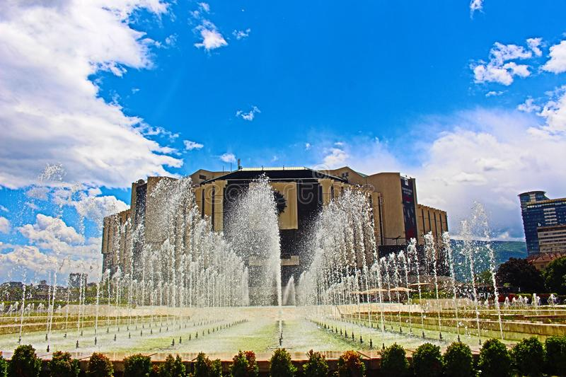 NDK SOFIA CENTER OF BULGARIA fountains during hot summer weather. This photo was taken from Sofia,fountain ndk may mount blue sky stock image