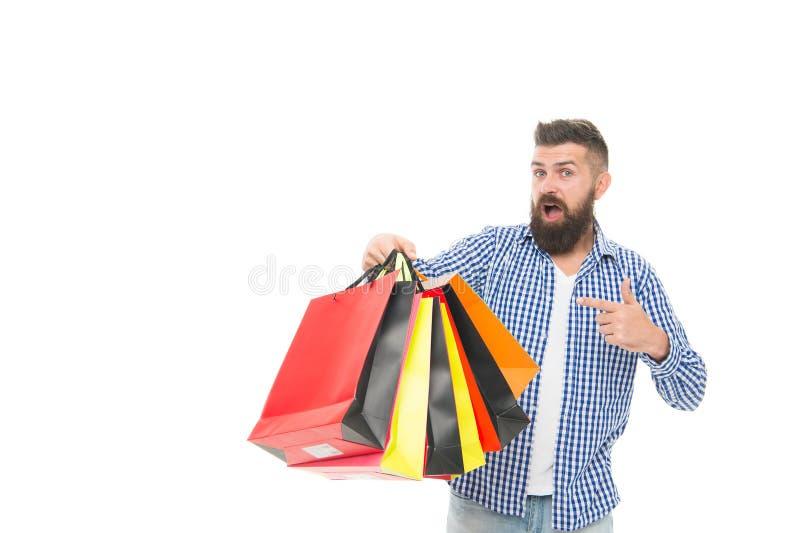 Ne manquez pas la vente Homme barbu dirigeant le doigt aux sacs à provisions après vente saisonnière d'isolement sur le blanc ?to photos stock
