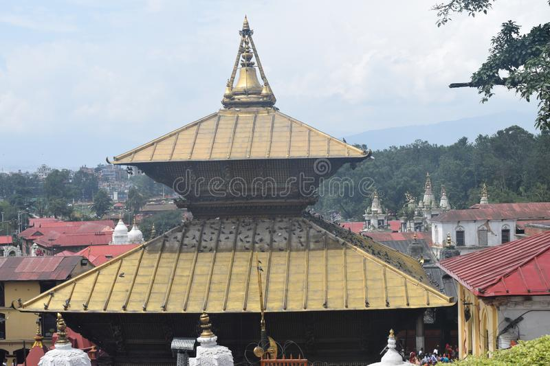 Pashupatinath Temple. Ne of the most sacred Hindu temples of Nepal – Pashupatinath Temple is located on both banks of Bagmati River on the stock images