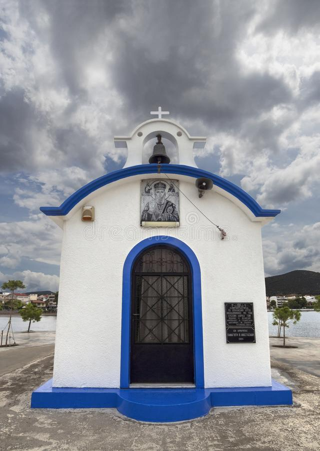 Nea Artaki, Evia Island, Greece. July 2019: Panoramic view of Little beautiful Greek church in blue and white colors on a sunny da. Nea Artaki, Evia Island royalty free stock photos