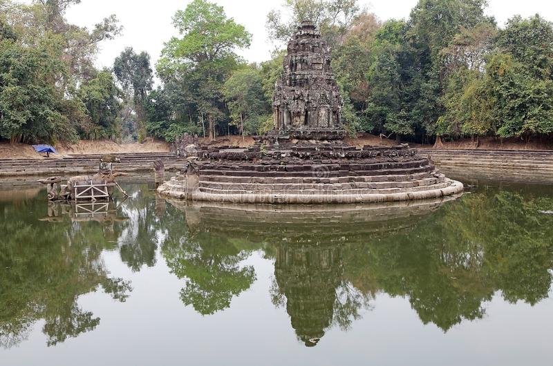 Neak Pean temple ruins. Angkor, Siem Reap, Cambodia. Neak Pean is an artificial island with a Buddhist temple on a circular island in Preah Khan Baray built stock photography