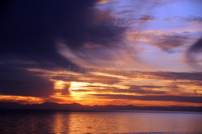Storm Clouds at Sunset, Sea of Cortez. Near El Golfo de Santa Clara, Sonora, Mexico. Storm clouds begin to move in over the water just as the sun is about to set royalty free stock photo