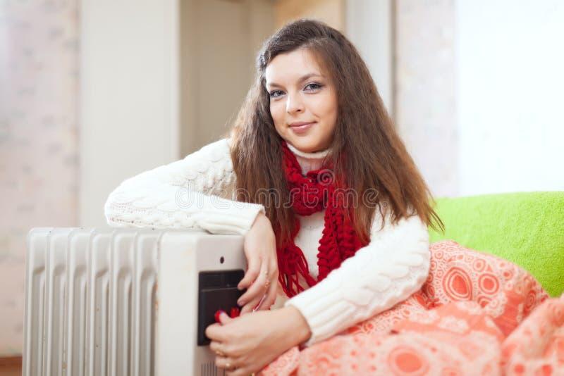 Near olje- värmeapparat för kvinna arkivbilder
