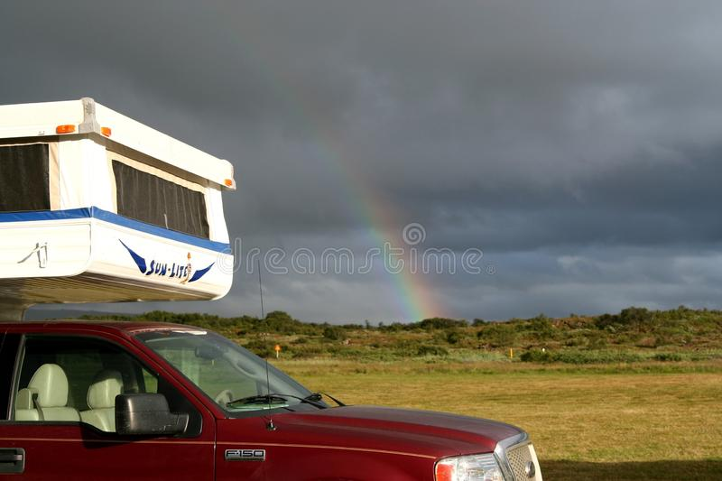 NEAR REYKJAVIK, ICELAND - JULY 28. 2008: Rainbow over hood of a Camper stock image