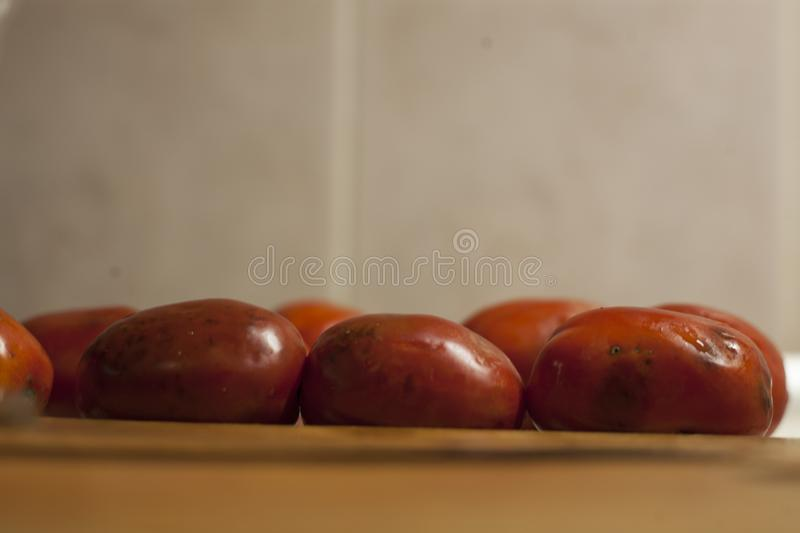 Tomatoes infected with phytophthora near a wooden board royalty free stock photo