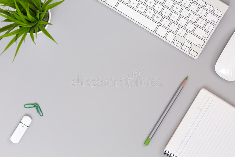 Neat Working Place on grey Table Business and Lifestyle Items royalty free stock images