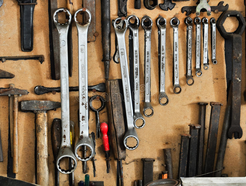 Neatly organized tools on a wall. Different tools organized on a wall royalty free stock photography