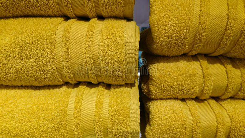 Coloured Bathroom Towels. Neatly placed bathroom towels stock photography