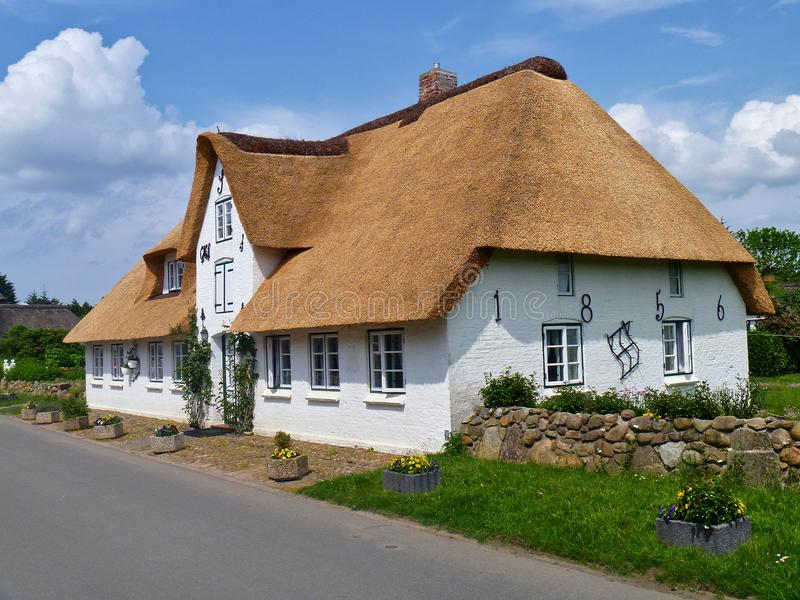 Nebel, Amrum, Germany - May 28th, 2016 - Traditional Frisian thatched cottage in the village of Nebel on the island of Amrum stock images
