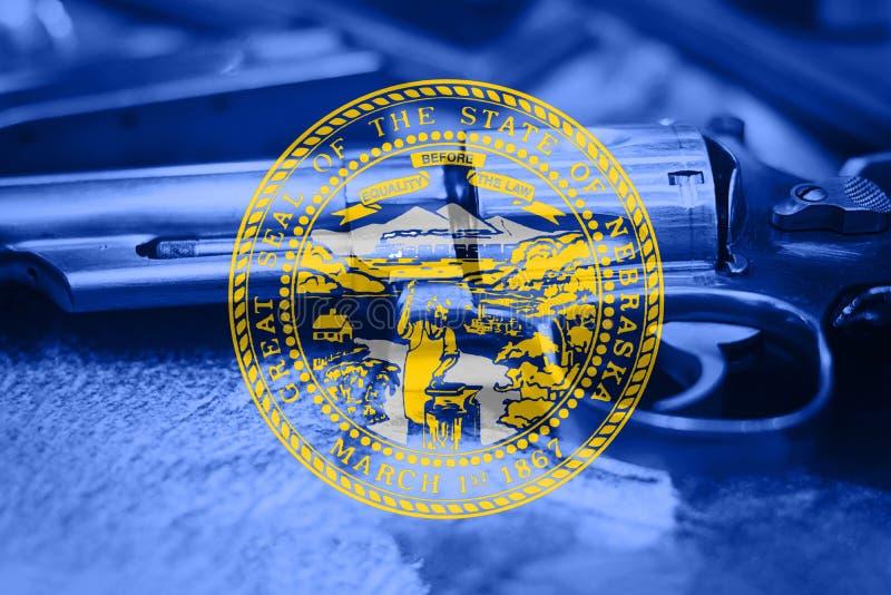 Nebraska flaga U S stan kontrola broni palnej usa Stany Zjednoczone pistolet fotografia royalty free