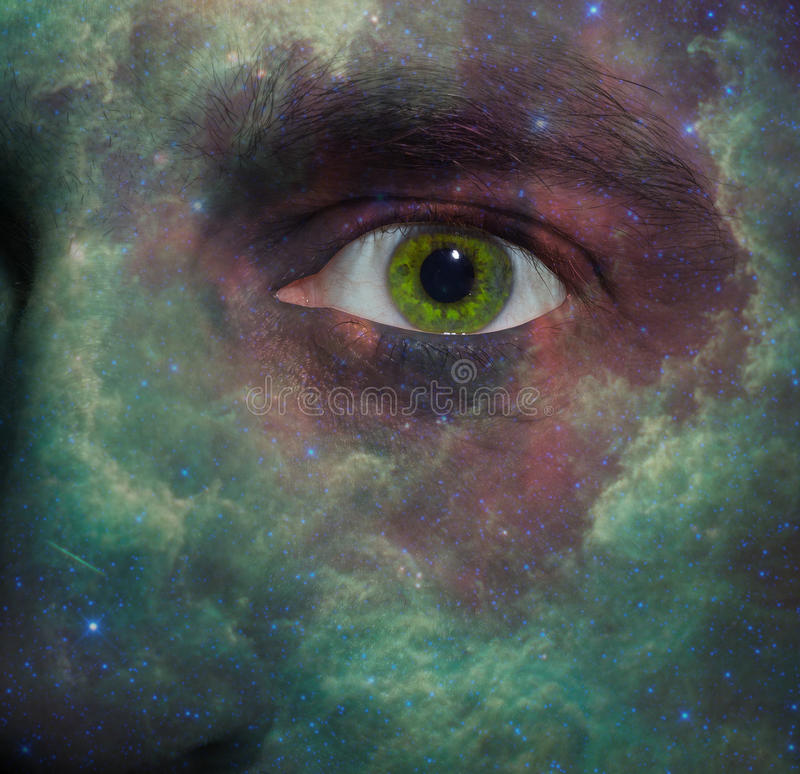 Nebula painted on a face. With a green eye royalty free stock images