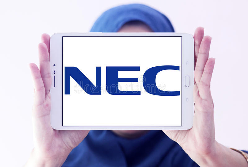 NEC Corporation logo. Logo of NEC Corporation on samsung tablet holded by arab muslim woman. NEC Corporation is a Japanese multinational provider of information royalty free stock image