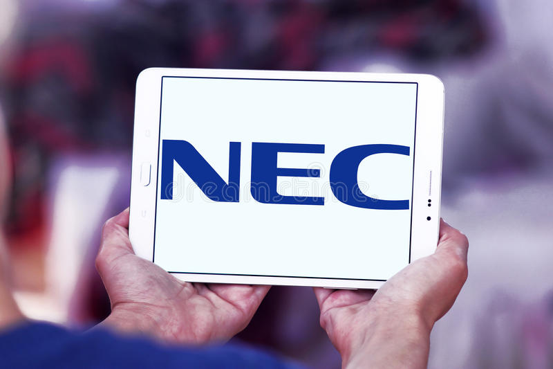 NEC Corporation logo. Logo of NEC Corporation on samsung tablet. NEC Corporation is a Japanese multinational provider of information technology IT services and royalty free stock photo