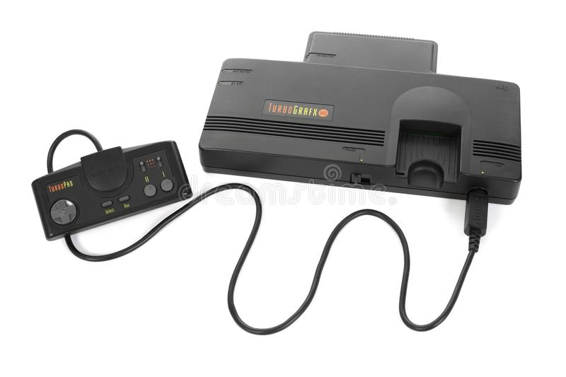 NEC`s TurboGrafx 16 Game System. Taipei, Taiwan - February 18, 2018: A studio shot of a NEC TurboGrafx 16 system with controller isolated on a white background stock image
