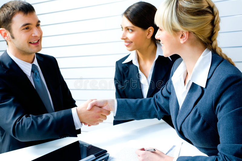 Necessary agreement. Successful people shaking hands making a necessary agreement