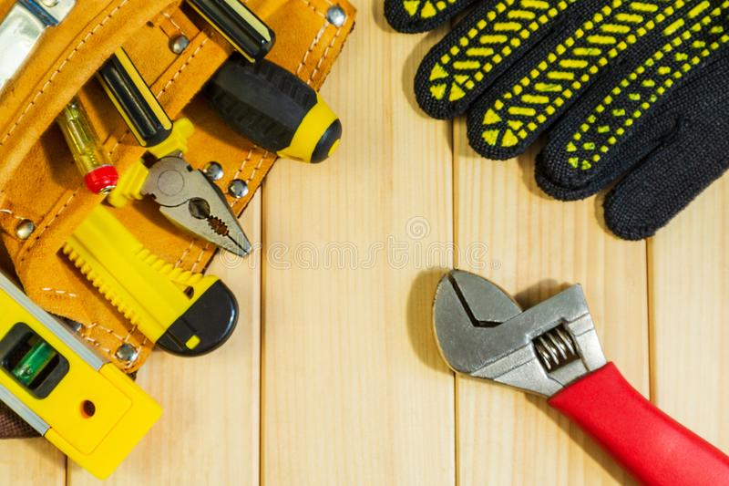 A necessary set of tools in a bag on a wooden background. A good choice for the master royalty free stock photo