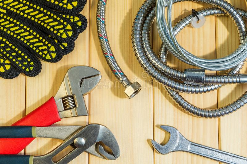 Necessary set of tools for plumbers on a wooden background. Indispensable for master. Also space for advertising royalty free stock image