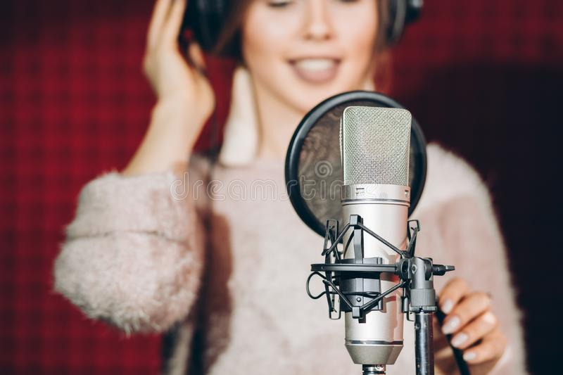 Necessary thing for recording song. People, girl is keen on music stock image