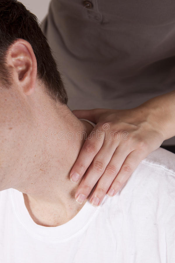 Neck adjustment. Close up shot of hand on neck, adjustment, massage royalty free stock images