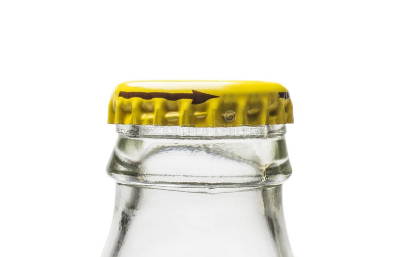 Neck of glass bottle from soda water with yellow metal stopper on white background royalty free stock photos