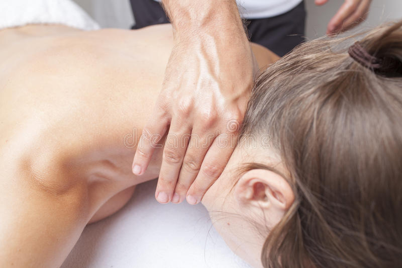 Neck massage. Chiropractic preparing for neck massage royalty free stock photos