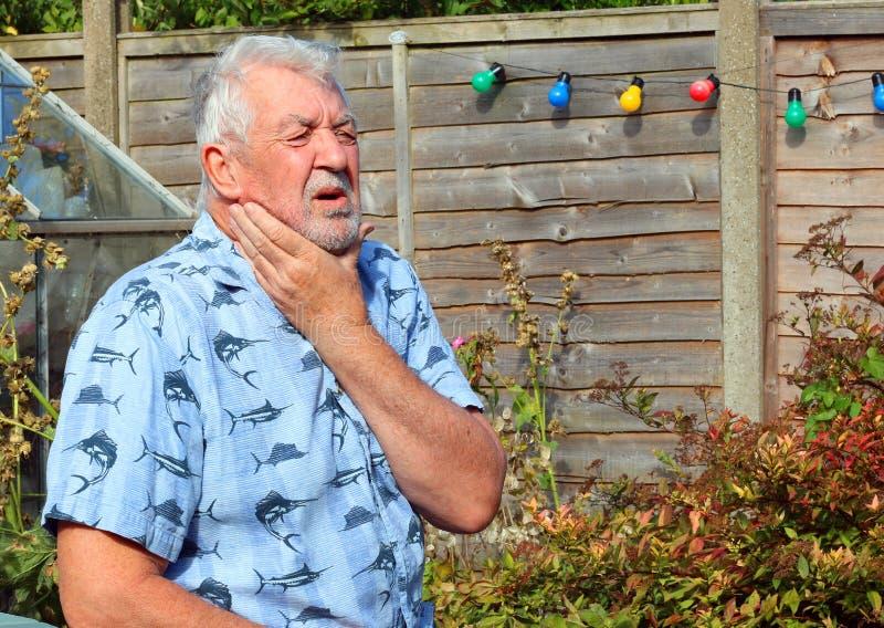 Neck pain. Arthritis. Stiff neck. Elderly or senior man holding his neck because of pains. Arthritis stock image