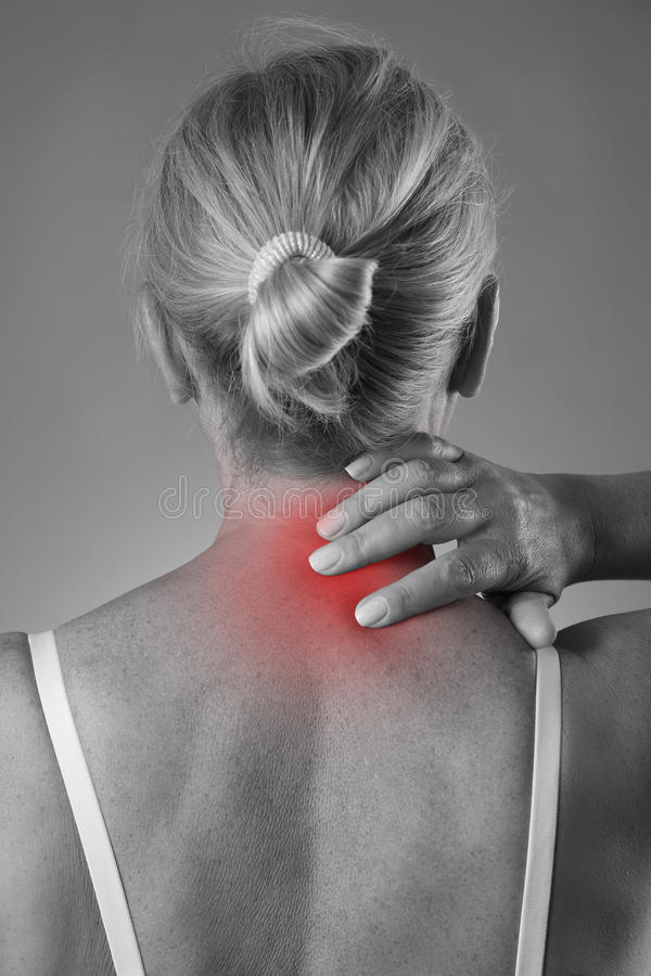 Neck pain, massage of female body, ache in woman`s body. Black and white photo with red spots royalty free stock photos
