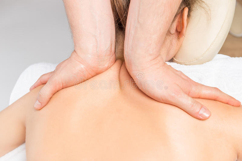 Neck and shoulder massage girls. In the salon stock photos